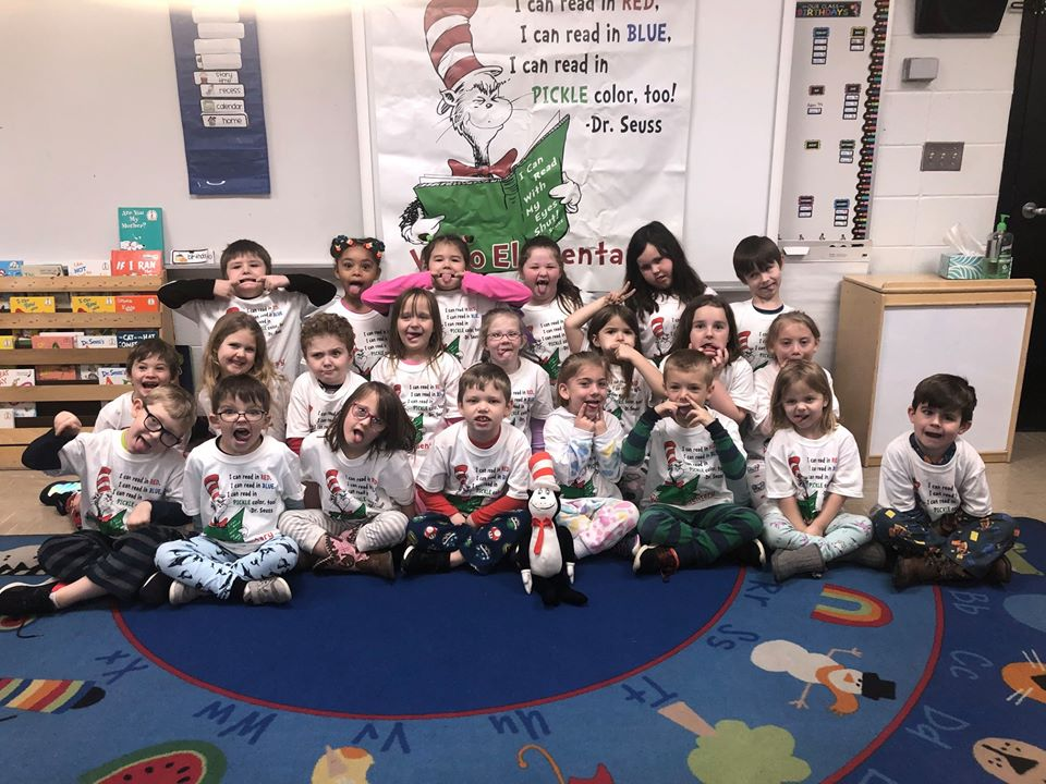 Classroom of students wearing Dr. Seuss t-shirts.