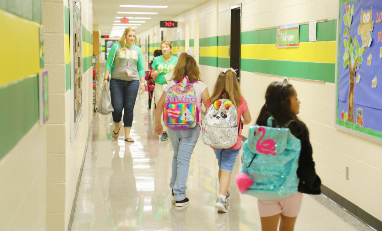 students walking down hallway