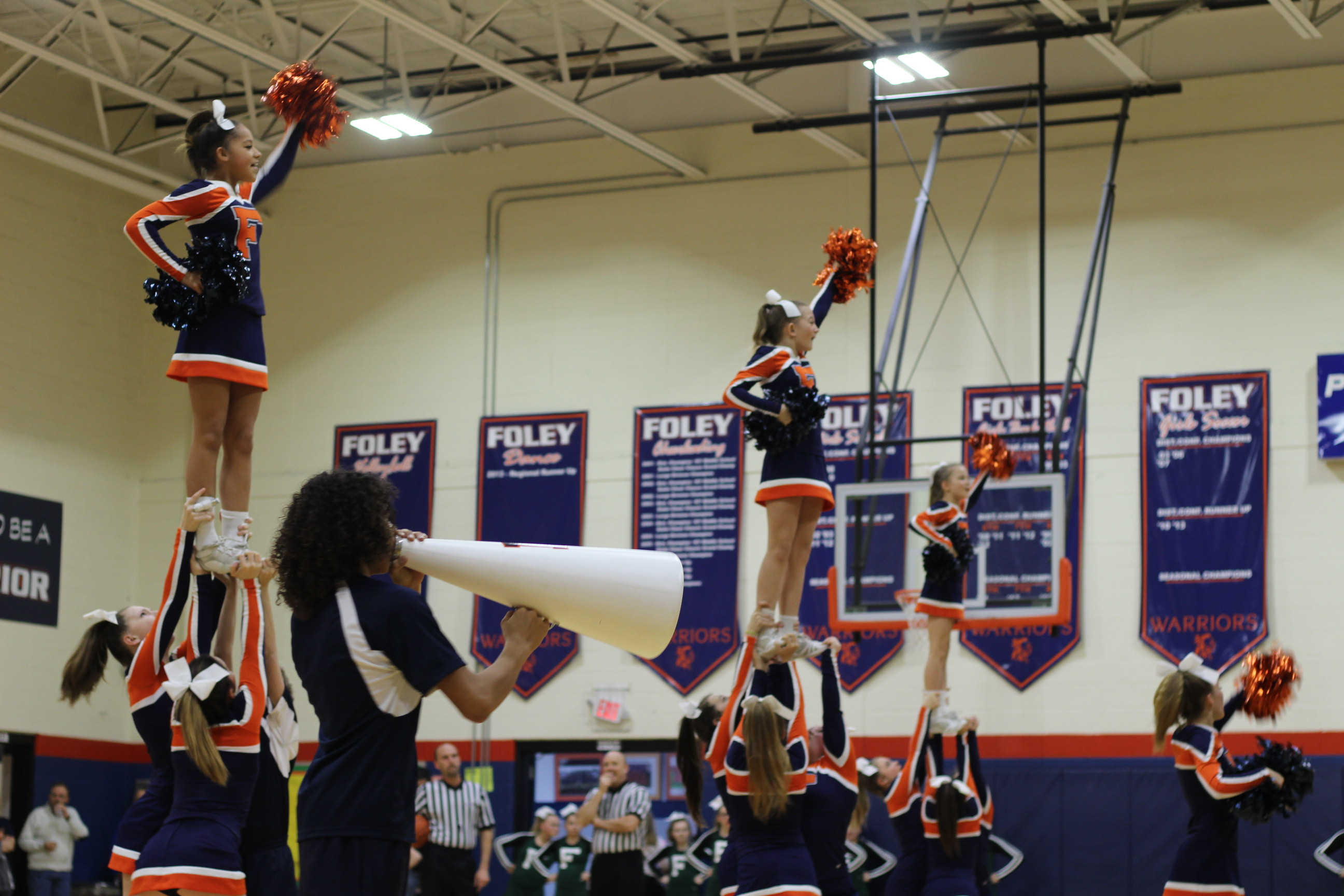 cheerleaders cheering at game