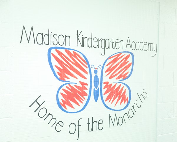 Madison Kindergarten Home of the Monarchs hall sign.